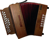 Sherwood D/G Melodeon, Cagnoni Reeds 2 1/2 row model with 27 treble buttons. 2 voice. 12 bass buttons