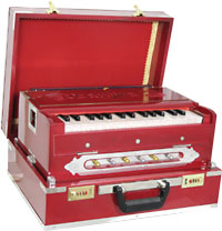 Atlas 2 1/2 Octave Harmonium Needs some TLC to make them play, un- happy reeds and sticky keys