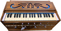 Atlas 3 Octave Harmonium Range is C to D. 4 drones and 2 voices. Brass reeded.